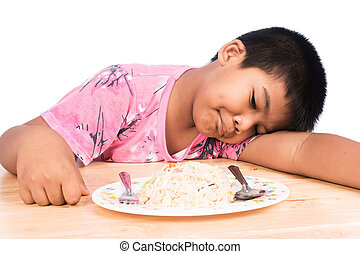 Cute little boy bored with food