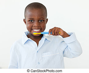 Cute little boy brushing her teeth at home