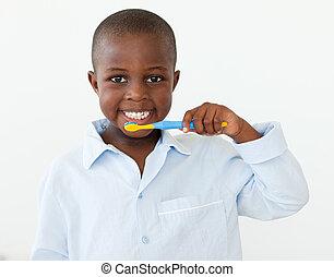 Cute little boy brushing her teeth