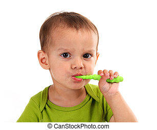 Cute little boy brushing teeth, isolated on white background