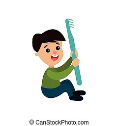 Cute little boy character sitting on the floor and holding giant toothbrush, cartoon vector Illustration