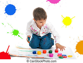 Cute little boy covered in bright paint