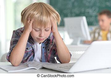 Cute little boy doing homework