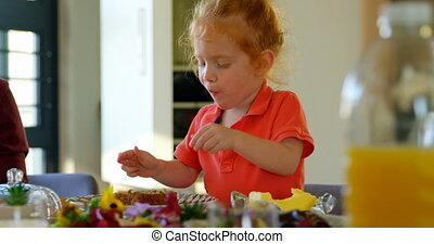 Cute little boy eating cake at dining table 4k - Cute little...