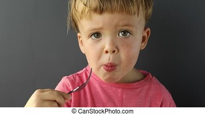 Cute little boy eating with fork - Charming infant boy in...