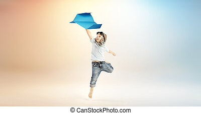 Cute little boy flying with the paper plane
