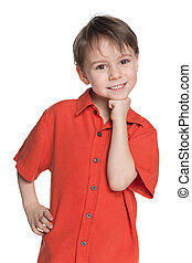 Cute little boy in a red shirt
