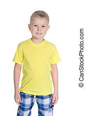 Cute little boy in a yellow shirt