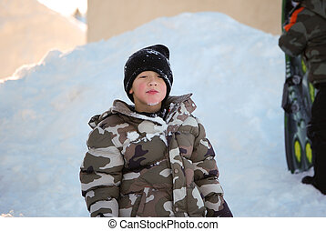 6bc970c68 Cute little boy riding motorcyle in the snow outdoors. Little boy in ...