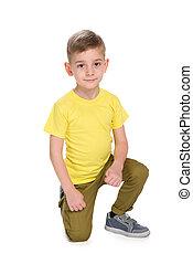 Cute little boy in the yellow shirt