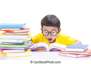 Cute little boy is reading a book