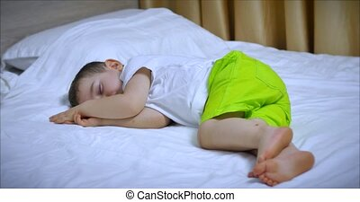 Cute Little Boy is Sleeping Sweetly in Bed, Concept of Baby Sleep.