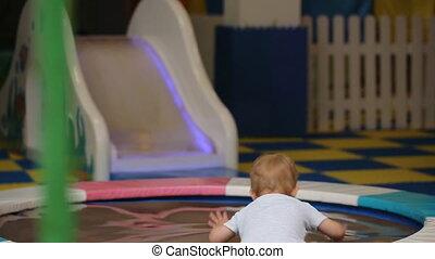 little boy jumping on a trampoline