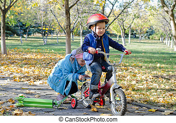 Cute little boy learning to ride