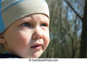 Cute little boy looking away