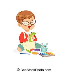 Cute little boy making figures from a plasticine, kids creativity vector Illustration