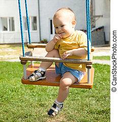 Cute little boy on swing