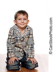 Cute little boy on the wooden floor