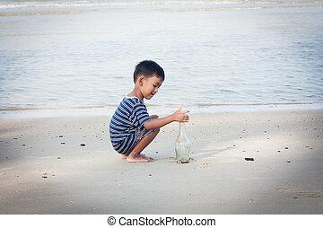 cute little boy play at the beach