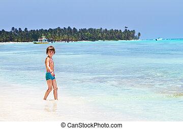 Cute little boy playing on the beach
