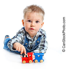 Cute little boy playing trains