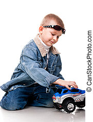 Cute little boy playing with car