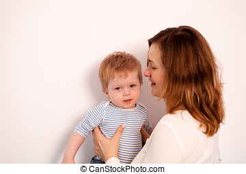 Cute Little boy playing with her mother