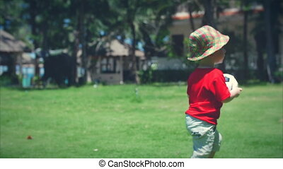 Cute little boy playing with soccer ball. Stock footage.