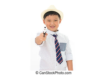 cute little boy playing with the gun toy isolated on white background