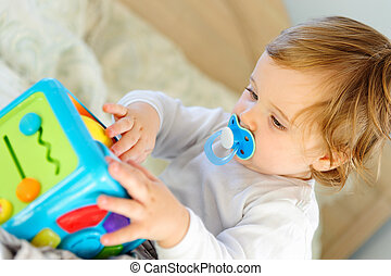 Cute little boy playing with toy
