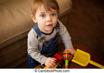 Cute little boy playing with toys - Portrait of an adorable ...