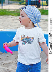 Cute  little boy plays on playground
