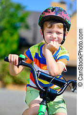 Cute little boy riding bicycle