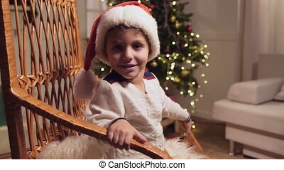 Cute little boy sitting in the rocking chair
