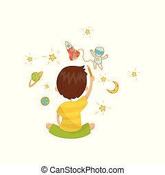 Cute little boy sitting on the floor and drawing with color pencils on the wall, back view, young artist, kids activity routine vector Illustration