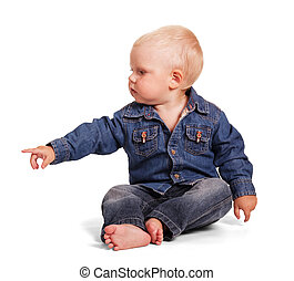 Cute little boy sitting with outstretched hand isolated .