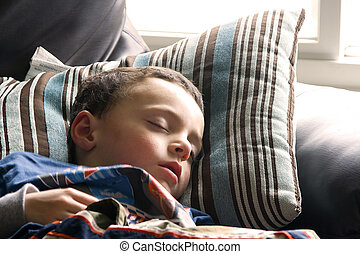 Cute Little Boy Sleeping on the Couch