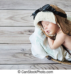 Cute little boy sleeping with goggles