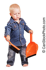 Cute little boy standing holding dustpan and brush isolated.