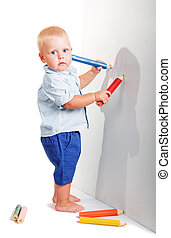 Cute little boy standing holding two pencil to draw isolated.