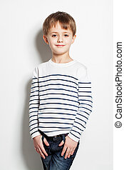 Cute little boy standing on background