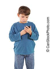 Cute little boy using smartphone