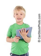 Cute little boy using tablet pc on white background