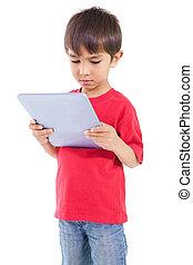 Cute little boy using tablet pc