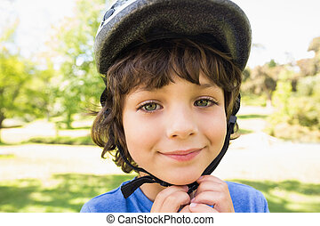Cute little boy wearing bicycle helmet - Close-up portrait...