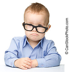 Cute little boy wearing glasses
