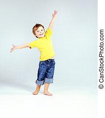 Cute little boy wearing yellow T-shirt