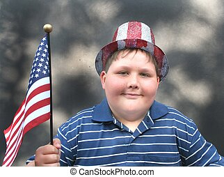 Cute little boy with 4th of july hat and flag