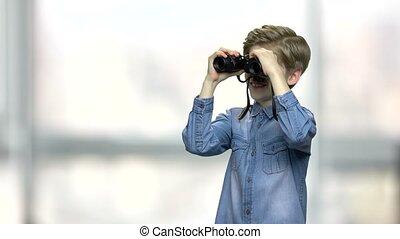Cute little boy with binoculars.