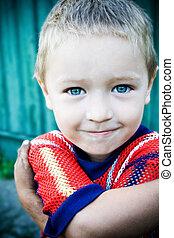 Cute little boy with deep blue eyes